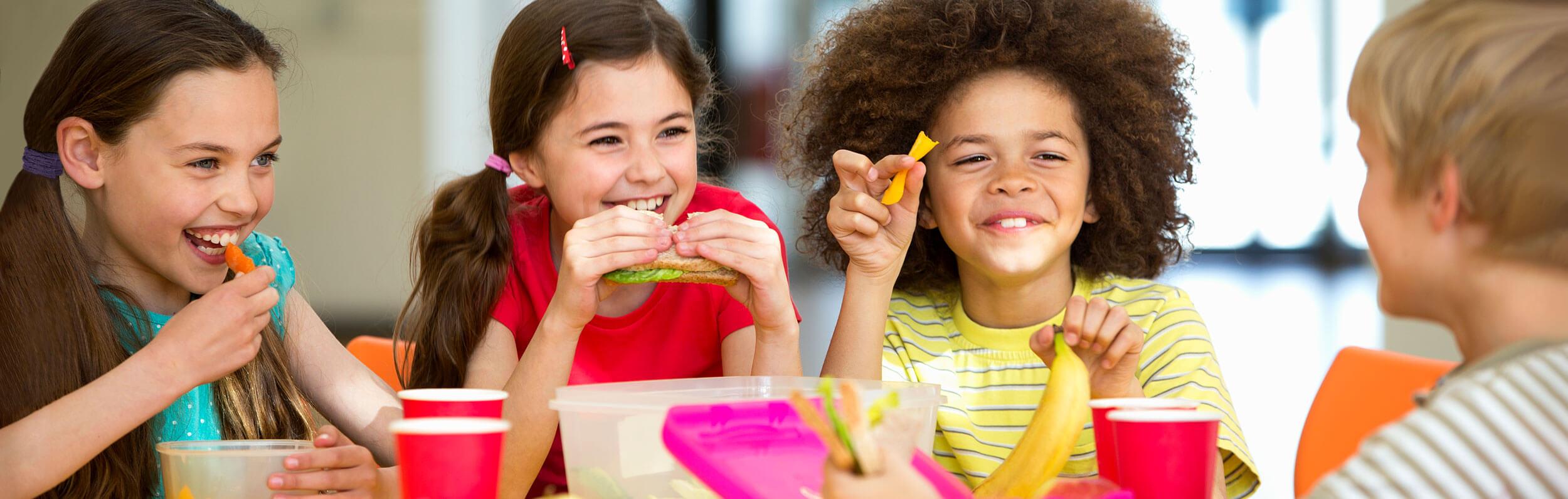 daycare meal plan - children eating together at a table - Novick Childcare