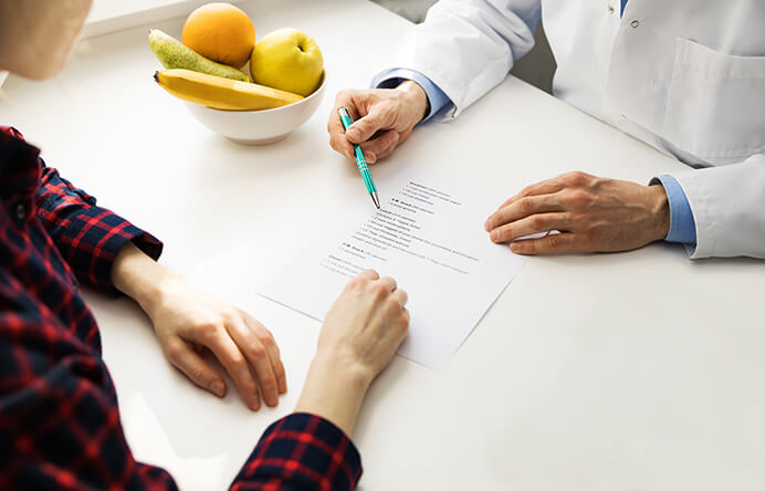 food program for daycare - hands on table reviewing nutritionist recommendation - Novick Childcare